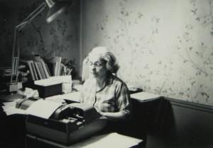 Dena at typewriter